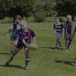 Young rugby players passing a ball